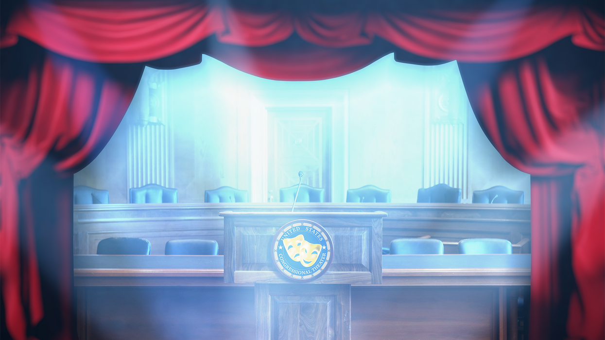 A Congressional hearing room surrounded by theatrical stage curtains.