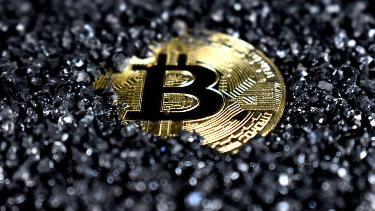 A crypto coin covered in black crystals
