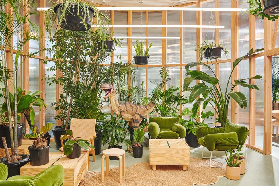 A meeting room with a blow-up dinosaur at a Dropbox Studio