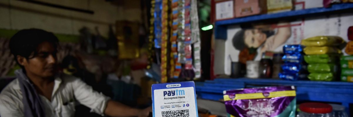 A Paytm digital barcode scanner in a storefront.