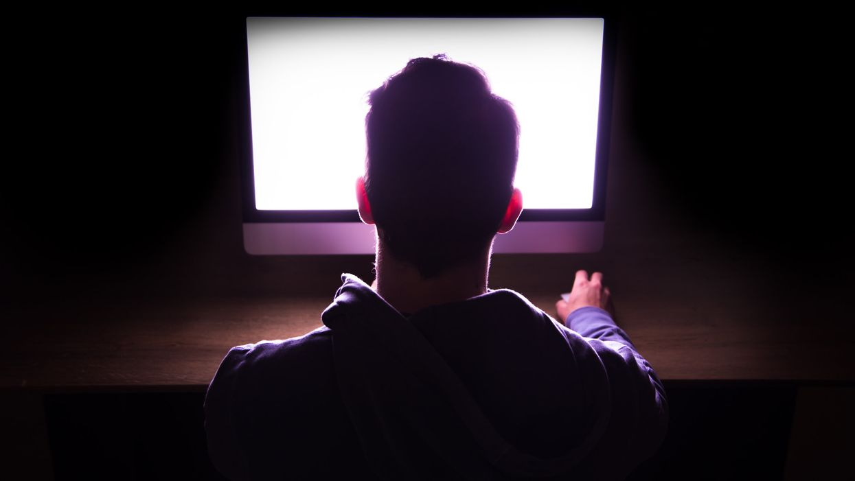 A person staring at a blank screen