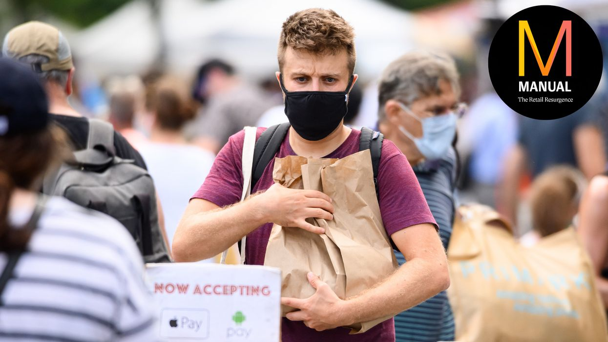 A person wears a face mask while shopping at the Union Square Greenmarket as the city continues Phase 4 of re-opening following restrictions imposed to slow the spread of coronavirus on August 22, 2020 in New York City. The fourth phase allows outdoor arts and entertainment, sporting events without fans and media production. (Photo by Noam Galai/Getty Images)