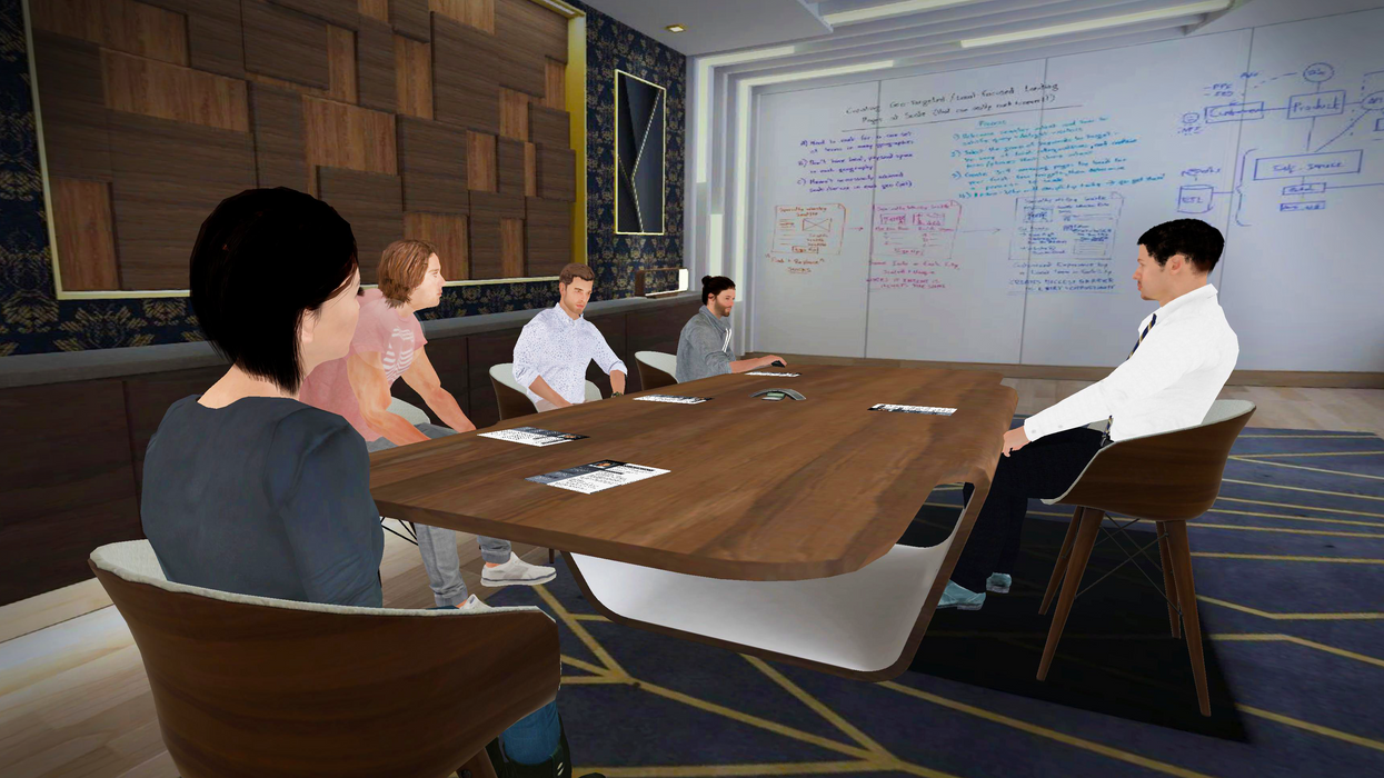 A virtual reality scene with five people sitting around a large table in front of a white board.
