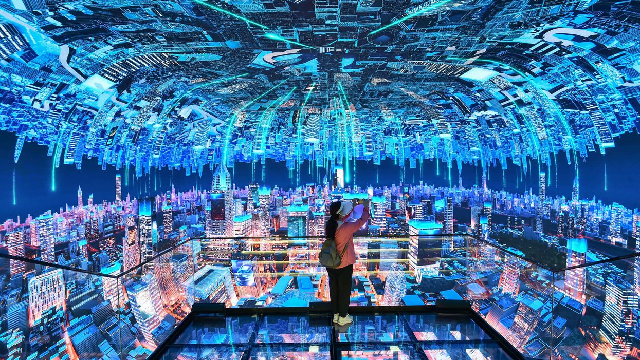 A visitor watches an elaborate digital video display.