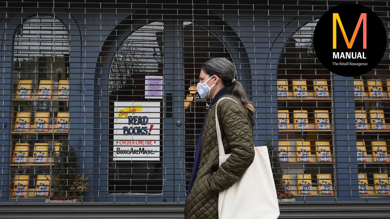A woman walks by the closed Books Are Magic bookstore on May 5, 2020 in the Brooklyn borough of New York. City. (Photo by Angela Weiss / AFP) (Photo by ANGELA WEISS/AFP via Getty Images)