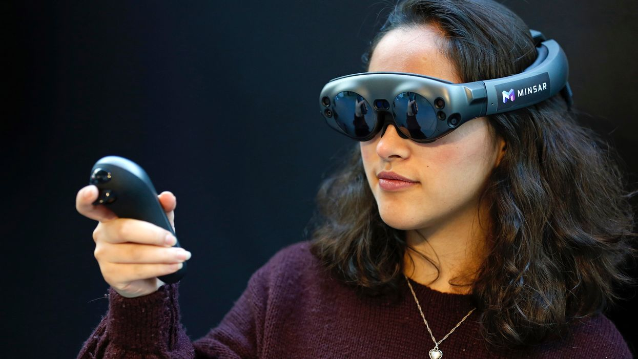 A woman wearing Magic Leap glasses