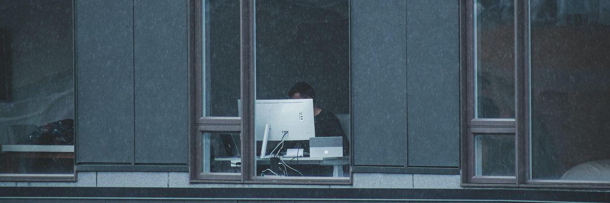 A worker hidden behind a computer