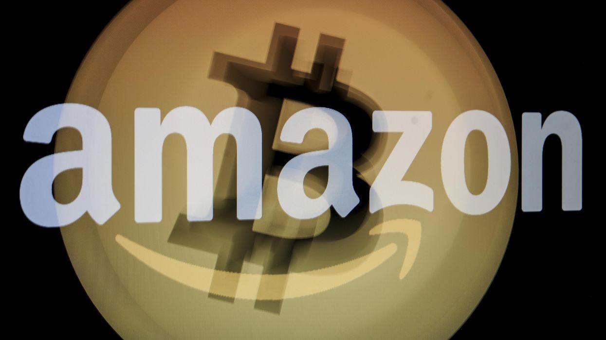 Amazon logo over bitcoin logo