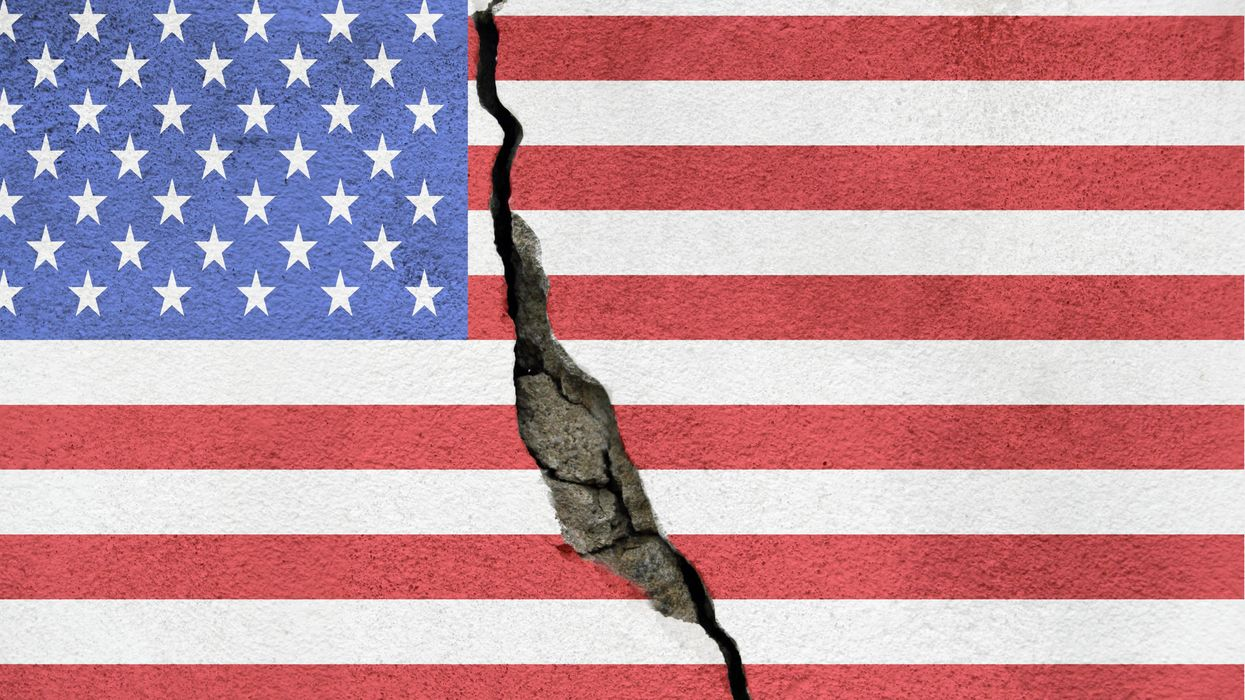 American flag with crack through middle