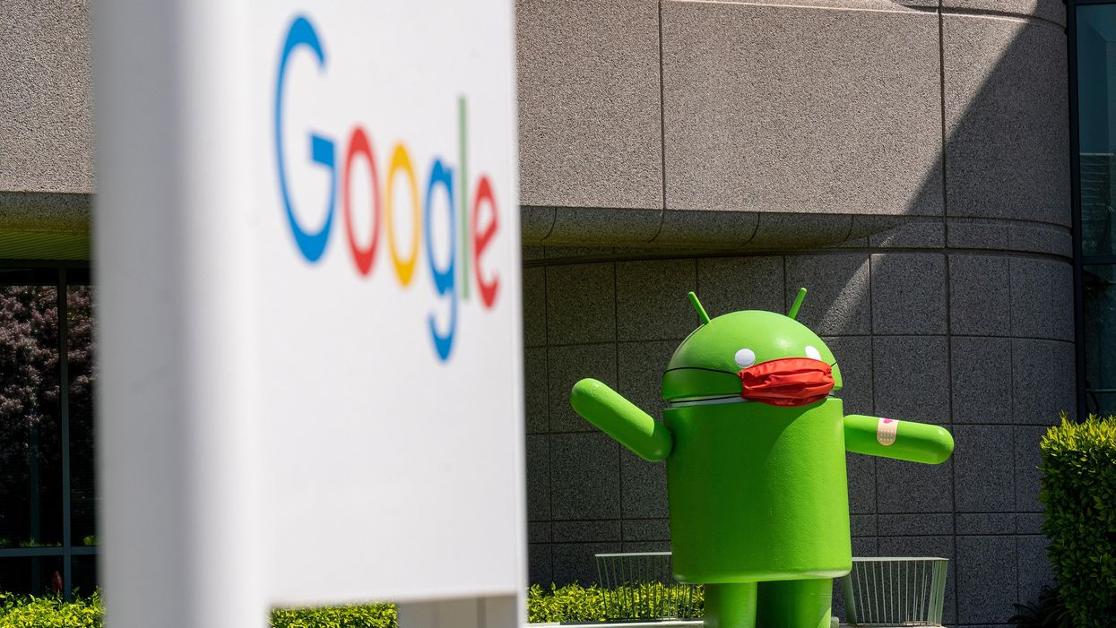 An Android statue wearing a mask on Google's campus
