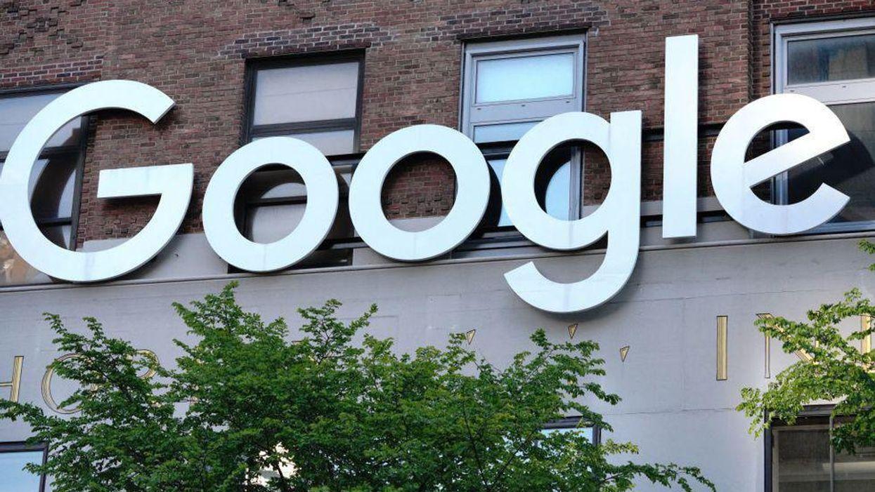 An exterior shot of the Google logo on an office building