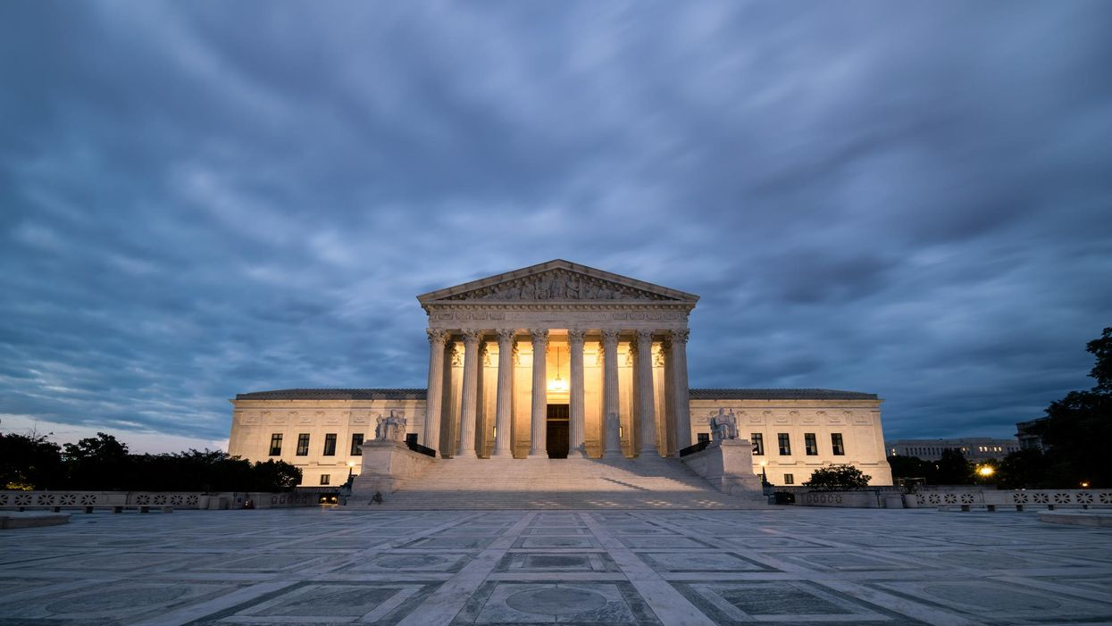 An exterior view of the Supreme Court on a cloudy day.