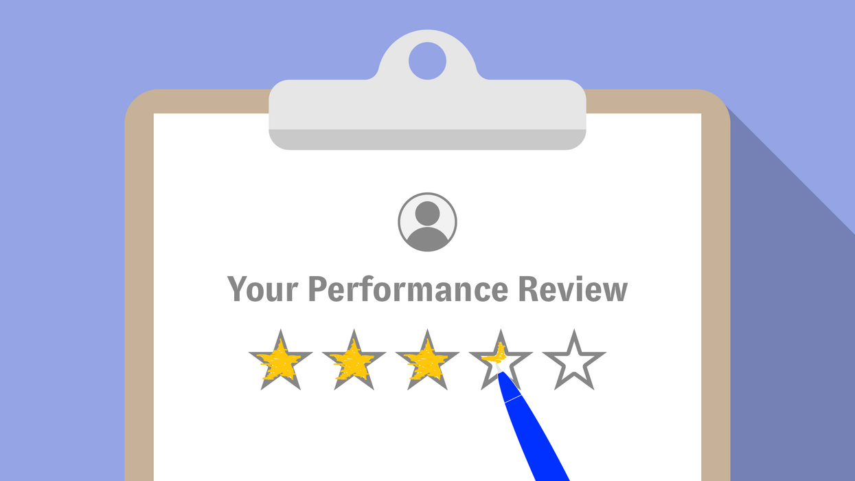 An illustration of a performance review on a clipboard.