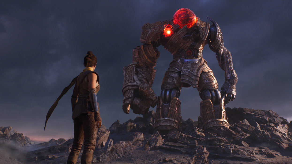 A screen captured render showing a woman, with her back to the camera, facing an enormous robotic creature
