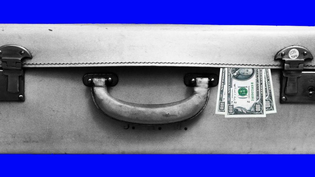 An image of a closed suitcase with $100 bills popping out.