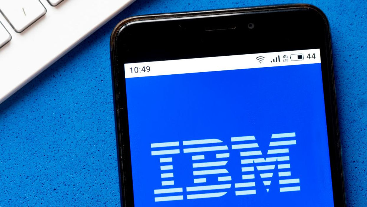 An iPhone showing IBM's logo