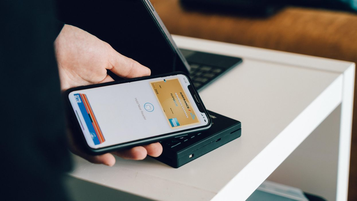An iPhone using Apple Pay