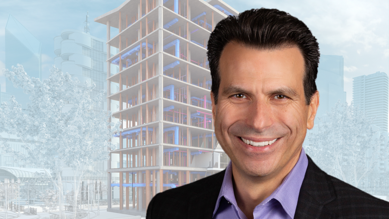 Andrew Anagnost smiling in the foreground. 3D design rendering of a building in the background.