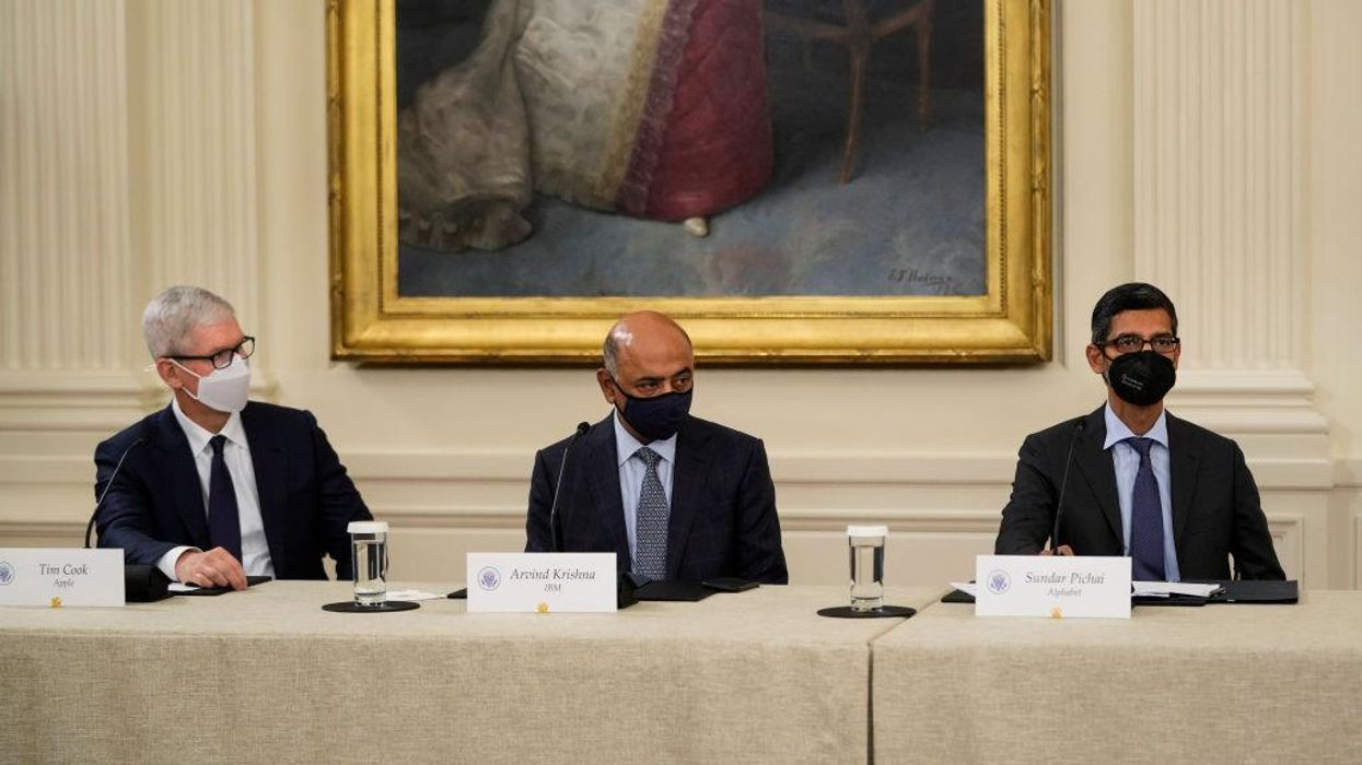 Apple CEO Tim Cook, IBM CEO Arvind Krishna and Google CEO Sundar Pichai at a conference table