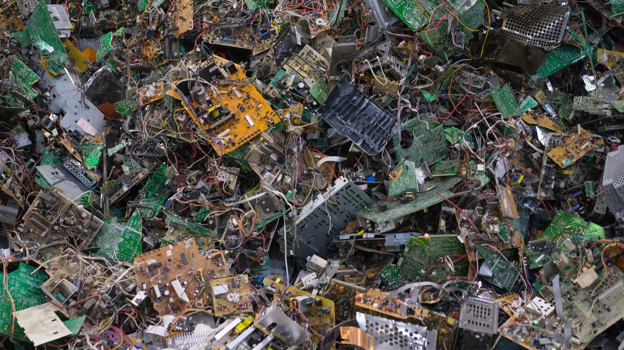 A mass of discarded electronics at a recycling plant.