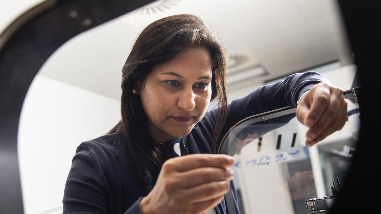 A woman working in a lab.