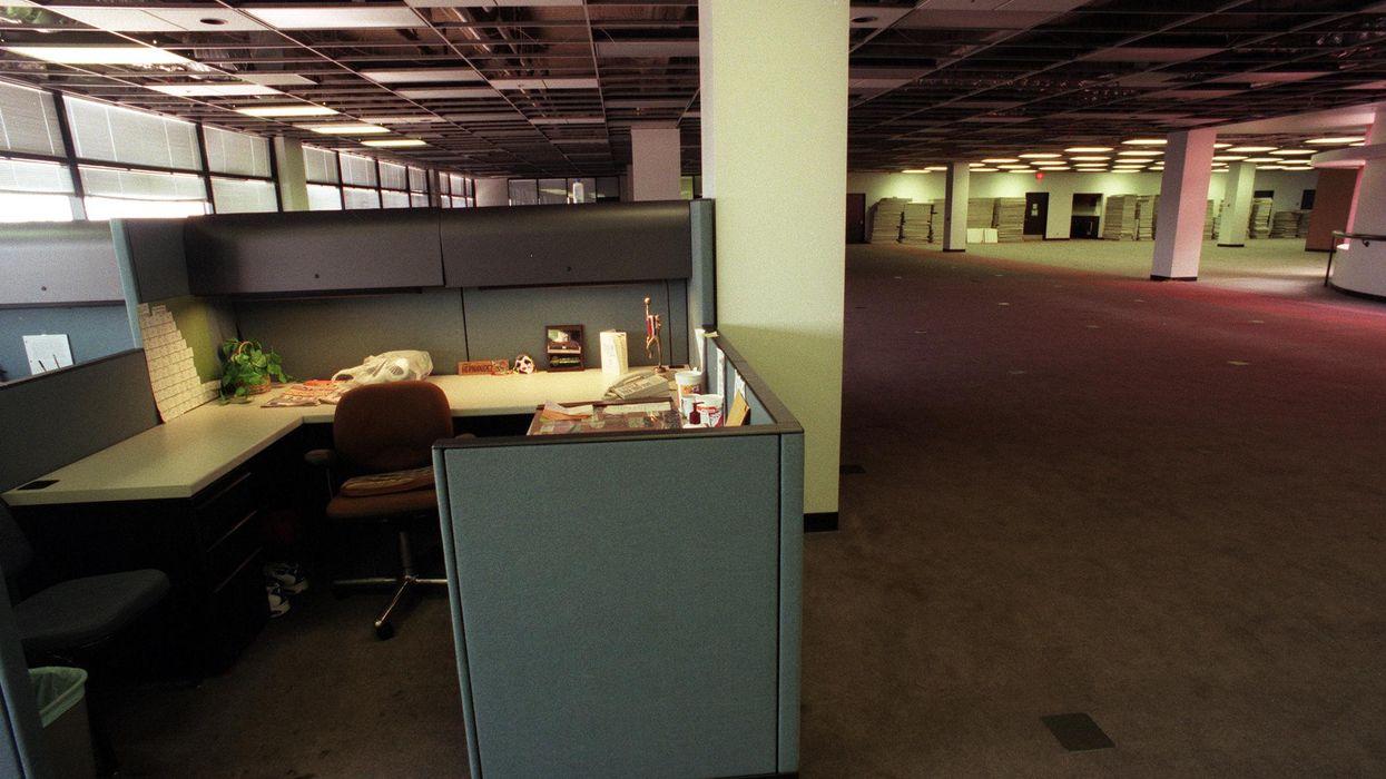 A desk in an empty office.
