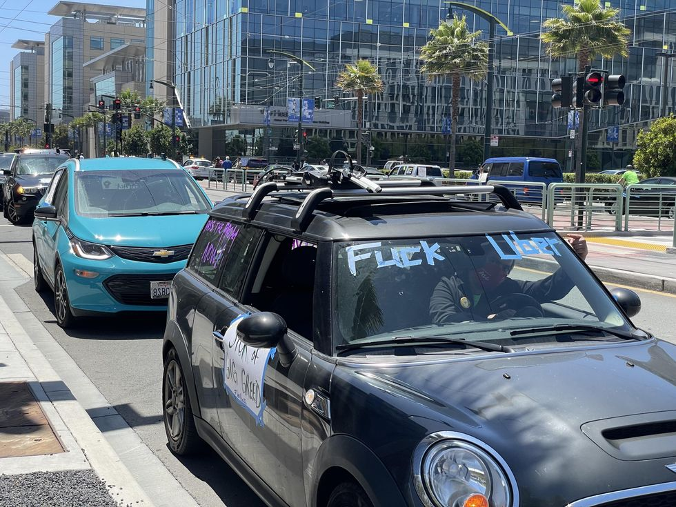 """Car with sign that says """"Fuck Uber"""""""