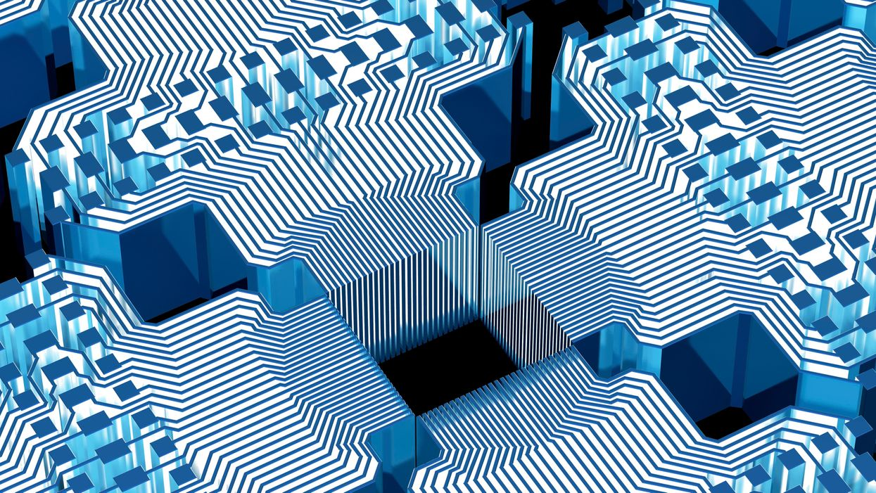 Conceptual computer artwork of electronic circuitry with blue light passing through it, representing how data may be controlled and stored in a quantum computer.