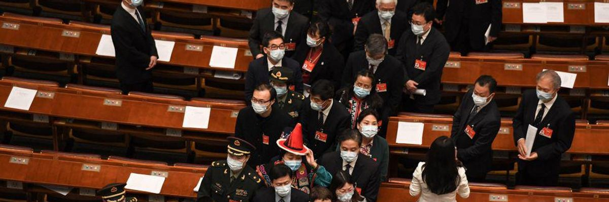 Delegates leave after the closing session of the Chinese People's Political Consultative Conference