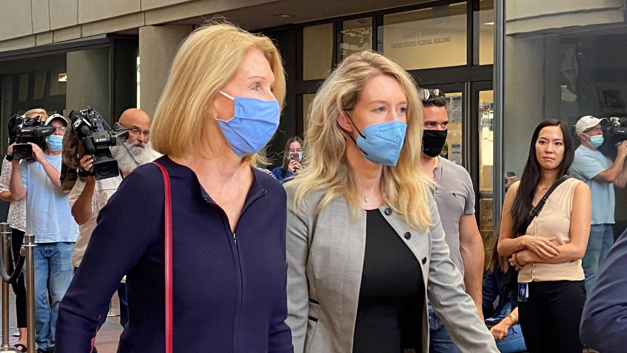 Elizabeth Holmes and her mother leave the courthouse in San Jose.