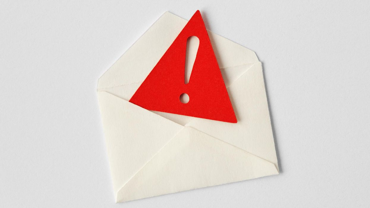 Envelope with red warning exclamation point coming out