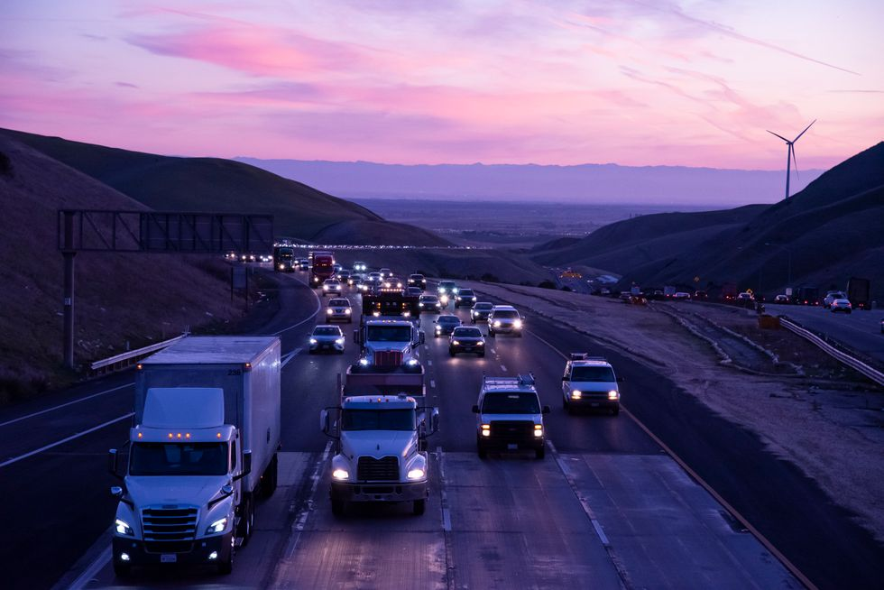Early-morning traffic builds over the Altamont Pass.