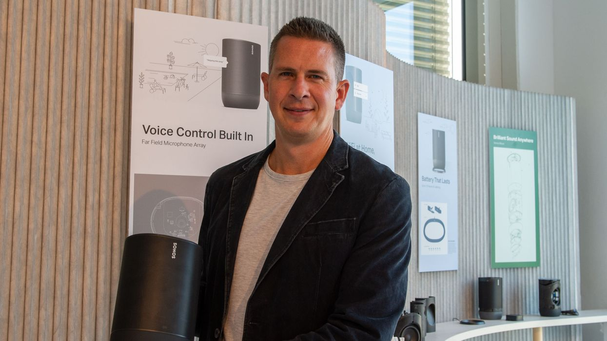 Patrick Spence holding a Sonos speaker