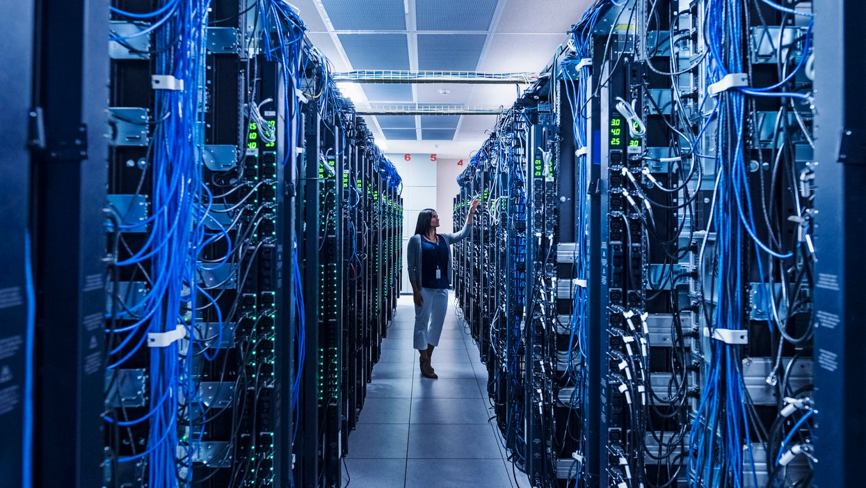 A woman in a server room