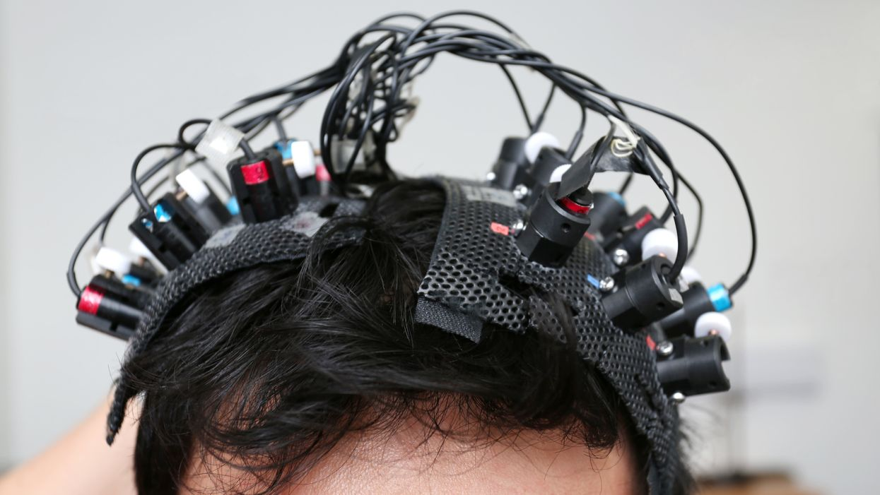 Person wearing a monitoring machine on head