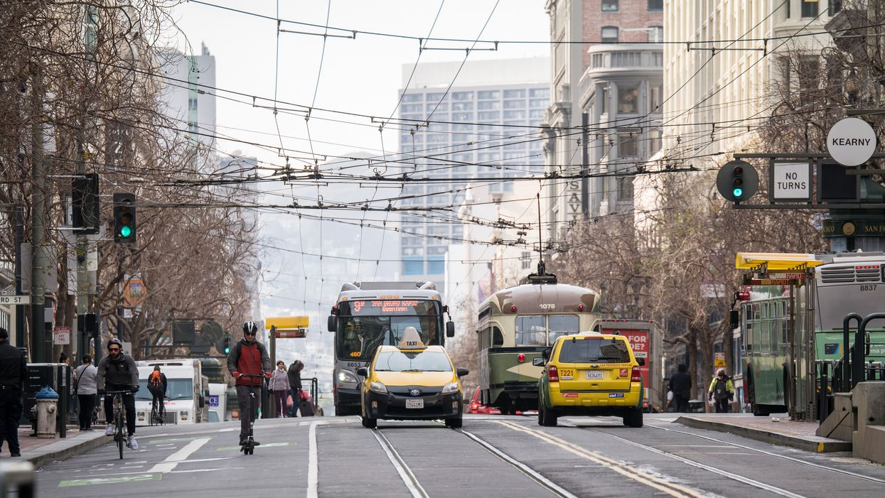 Various forms of transportation on Market Street in San Francisco