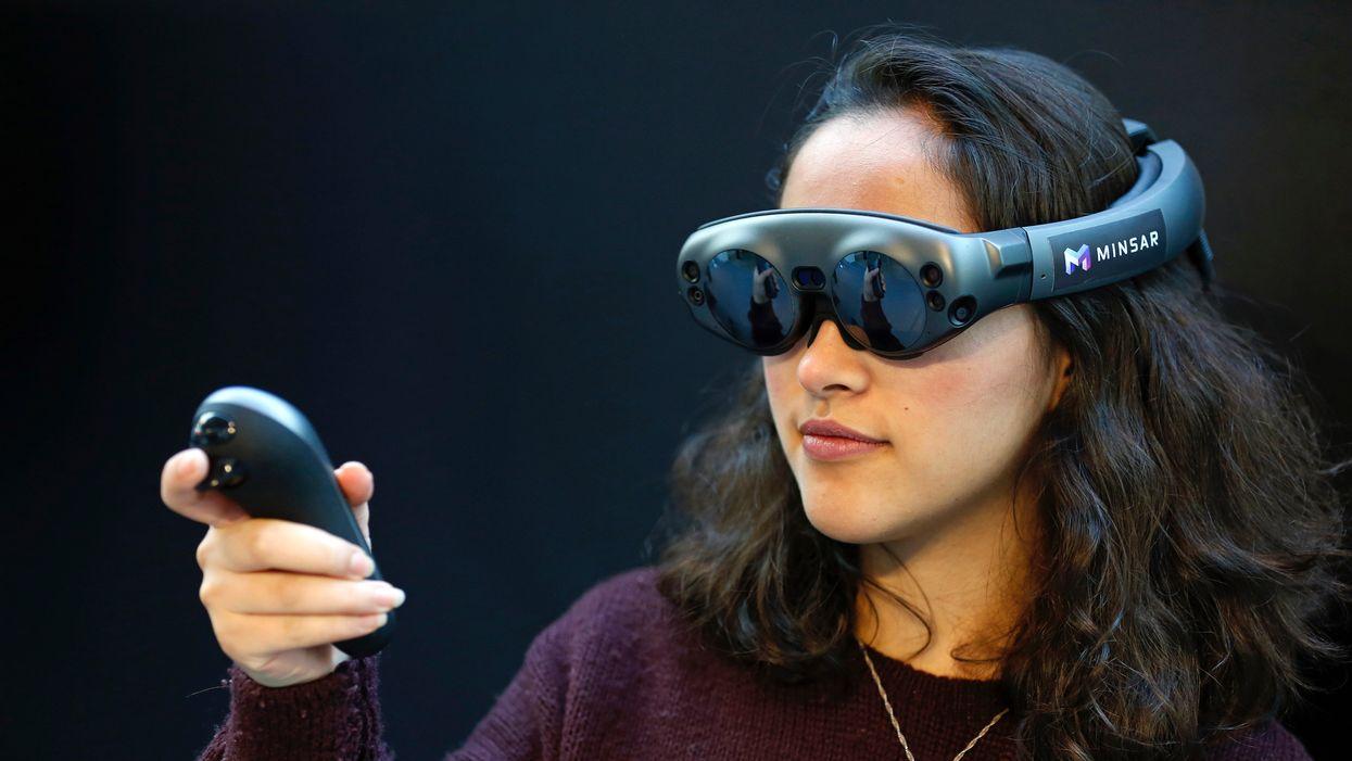 A woman uses a Magic Leap AR headset