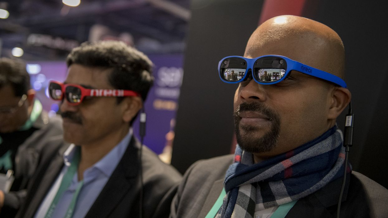 Attendees wear Nreal light mixed reality (MR) glasses during CES 2020 in Las Vegas