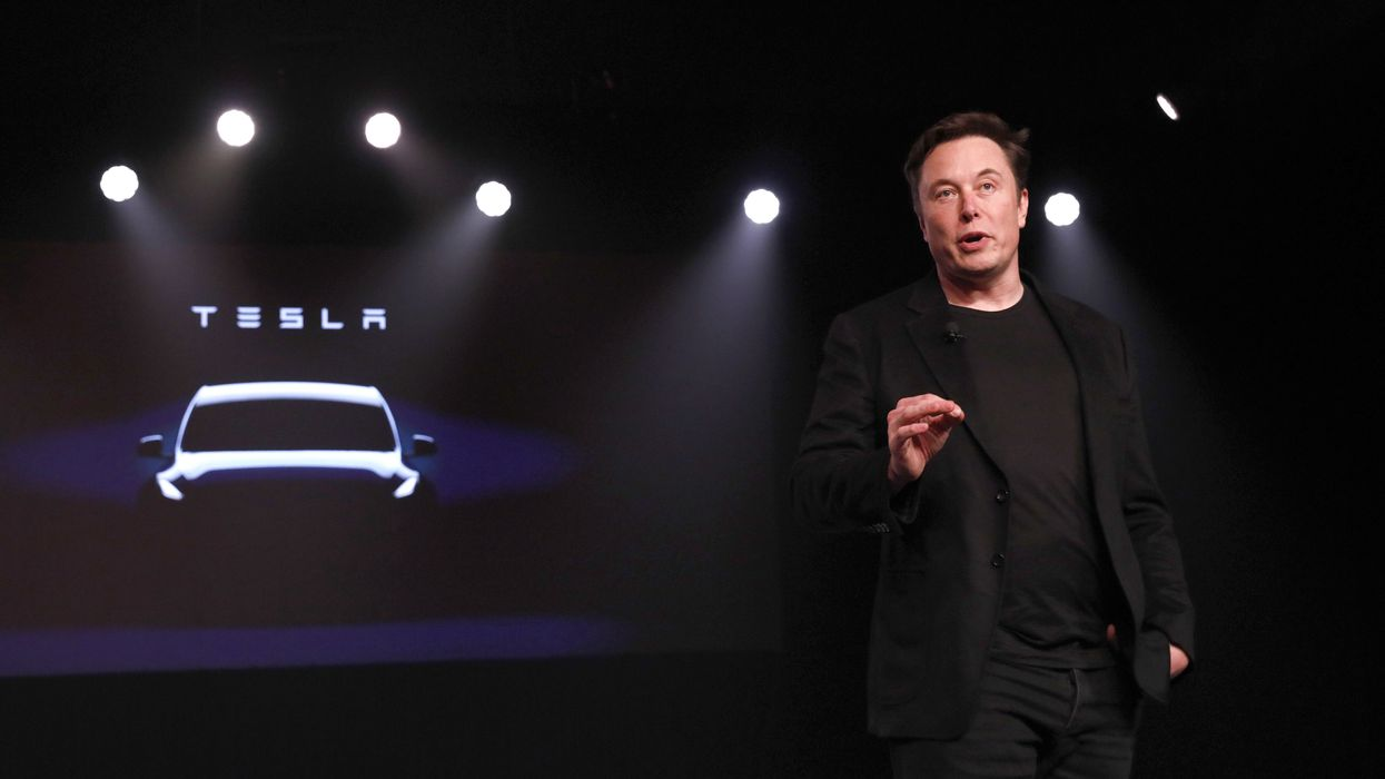 Tesla CEO Elon Musk unveiling the Model Y