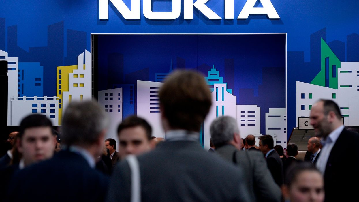 People visit the Nokia stand at the Mobile World Congress in 2019