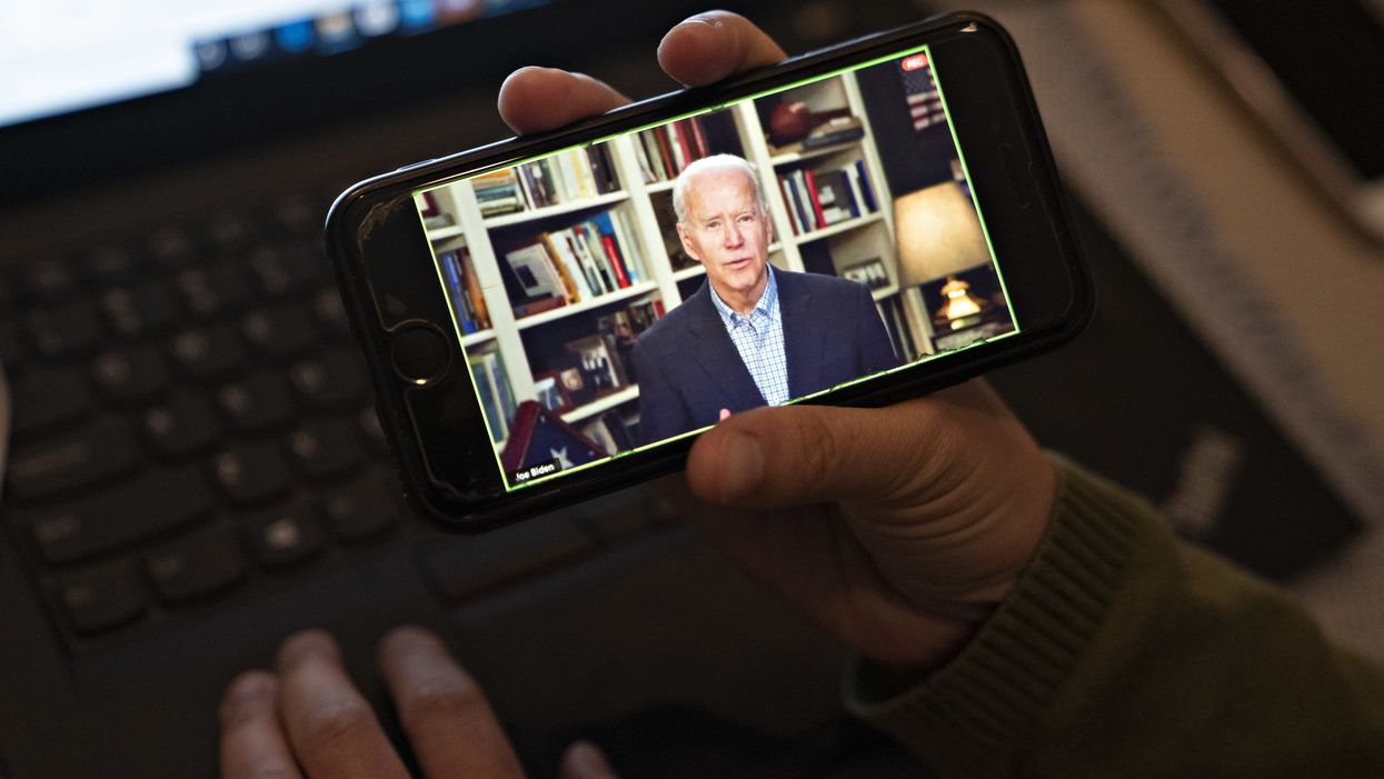 Someone looking at Joe Biden on a phone