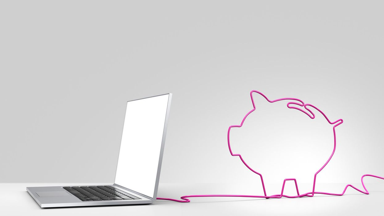 A laptop and a piggy bank