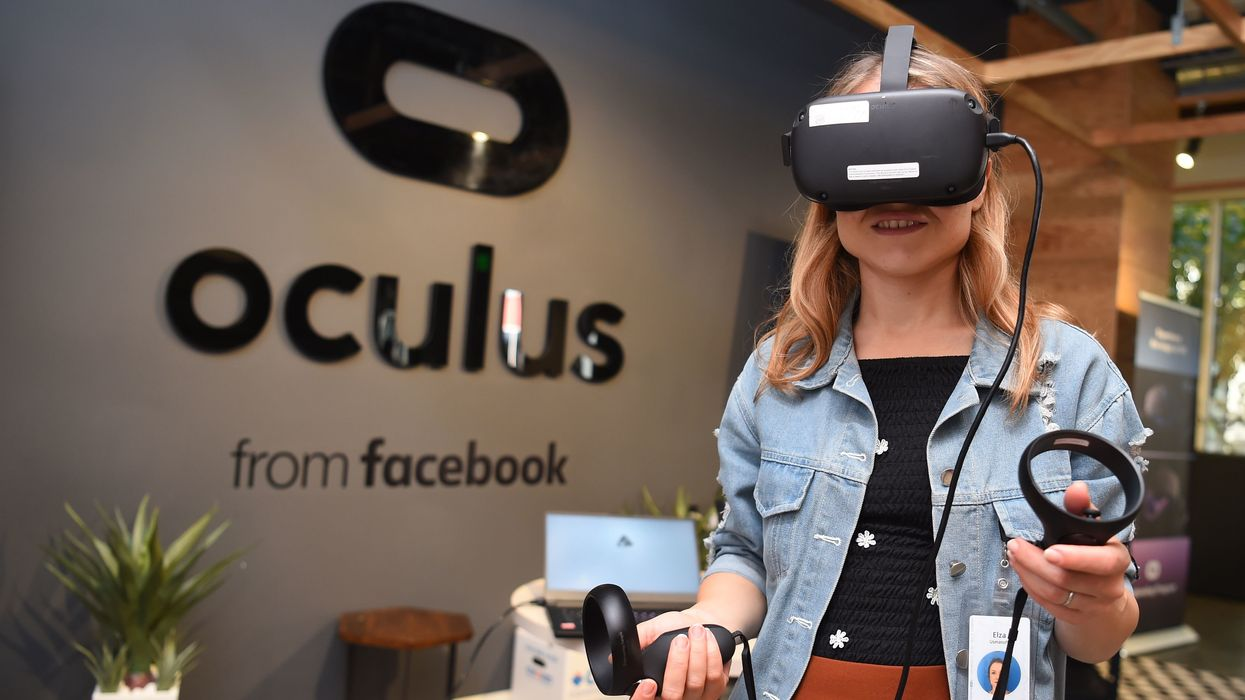 A woman wears an Oculus VR headset