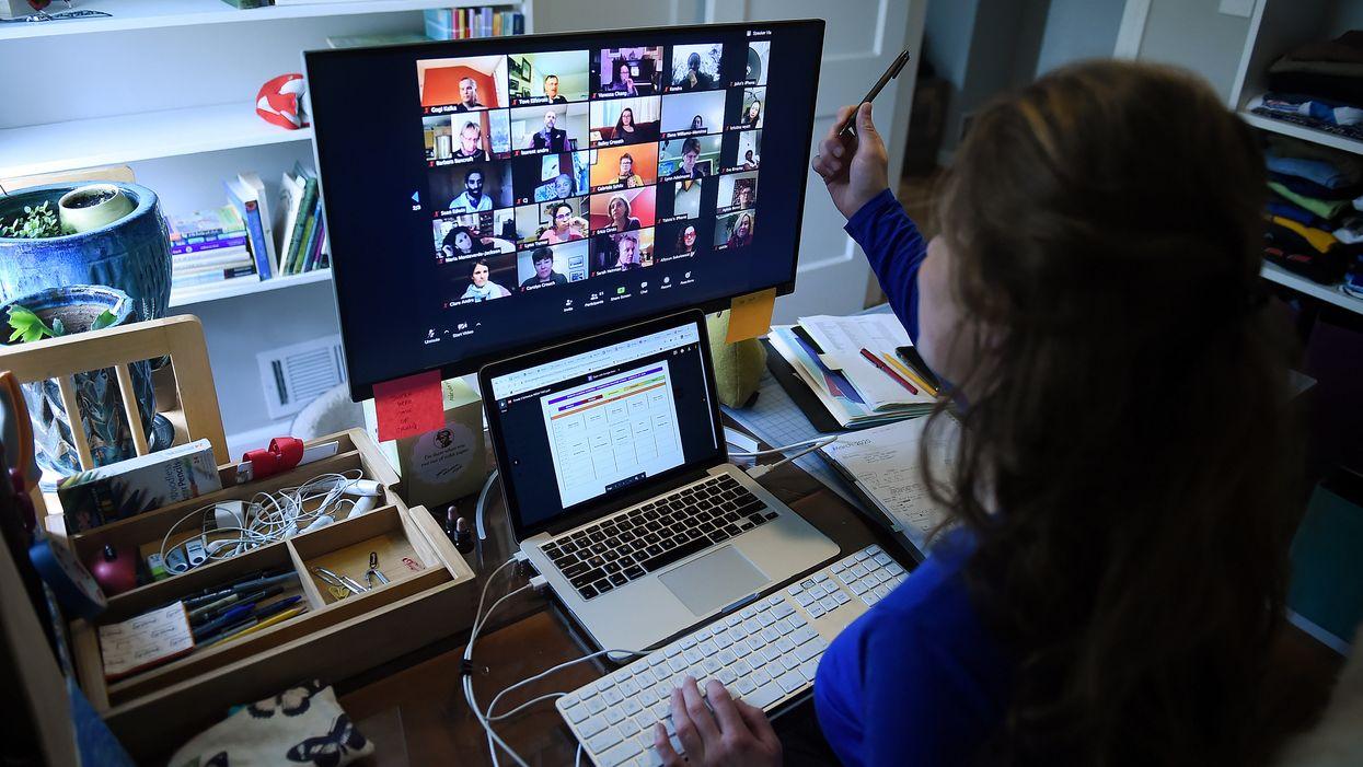 A teacher at a computer