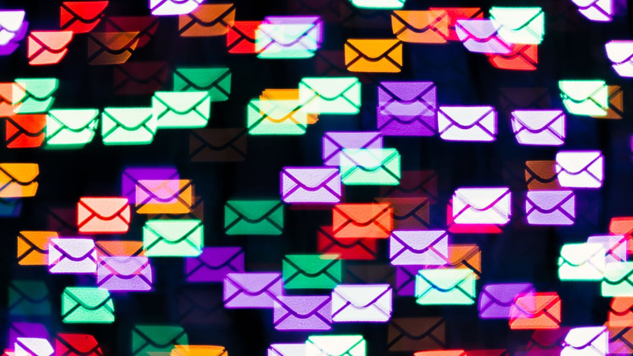 Email icons floating on a black background