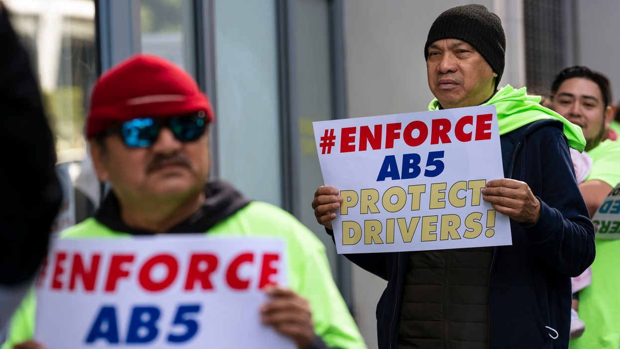 Driveshare workers hold signs supporting AB5