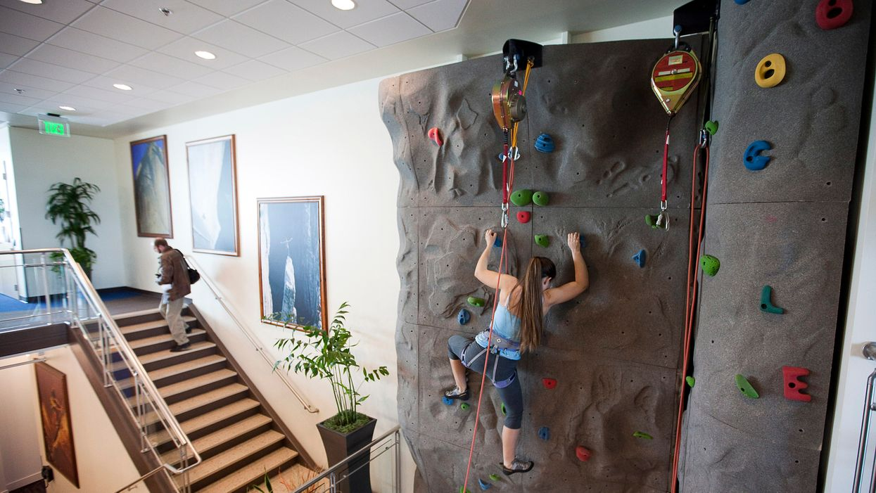 A woman on a climbing wall at Google