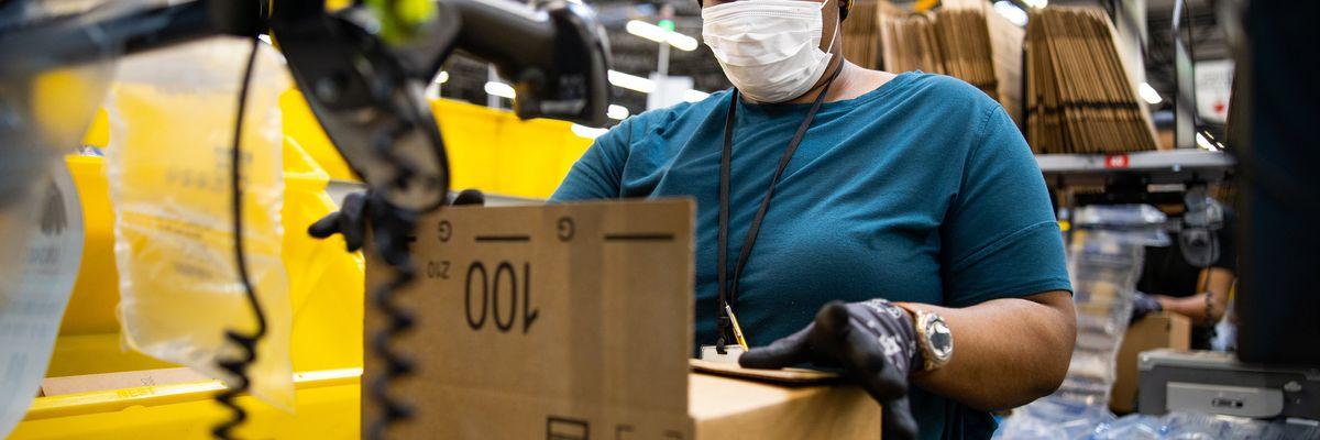 Amazon warehouse worker, wearing a mask