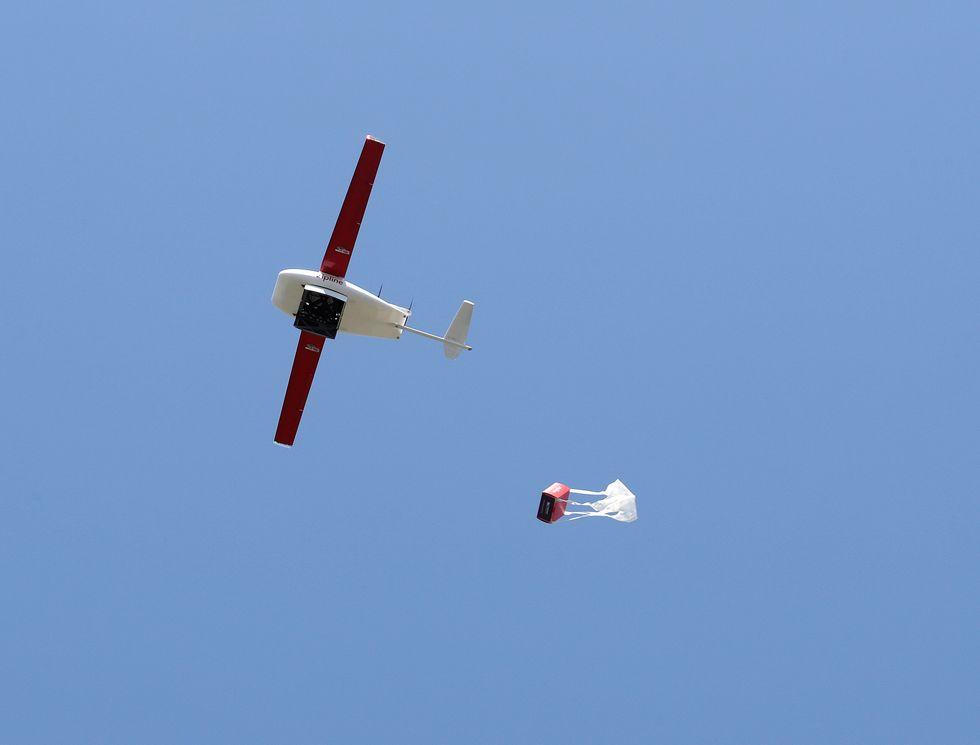 Zipline's drone drops a package.