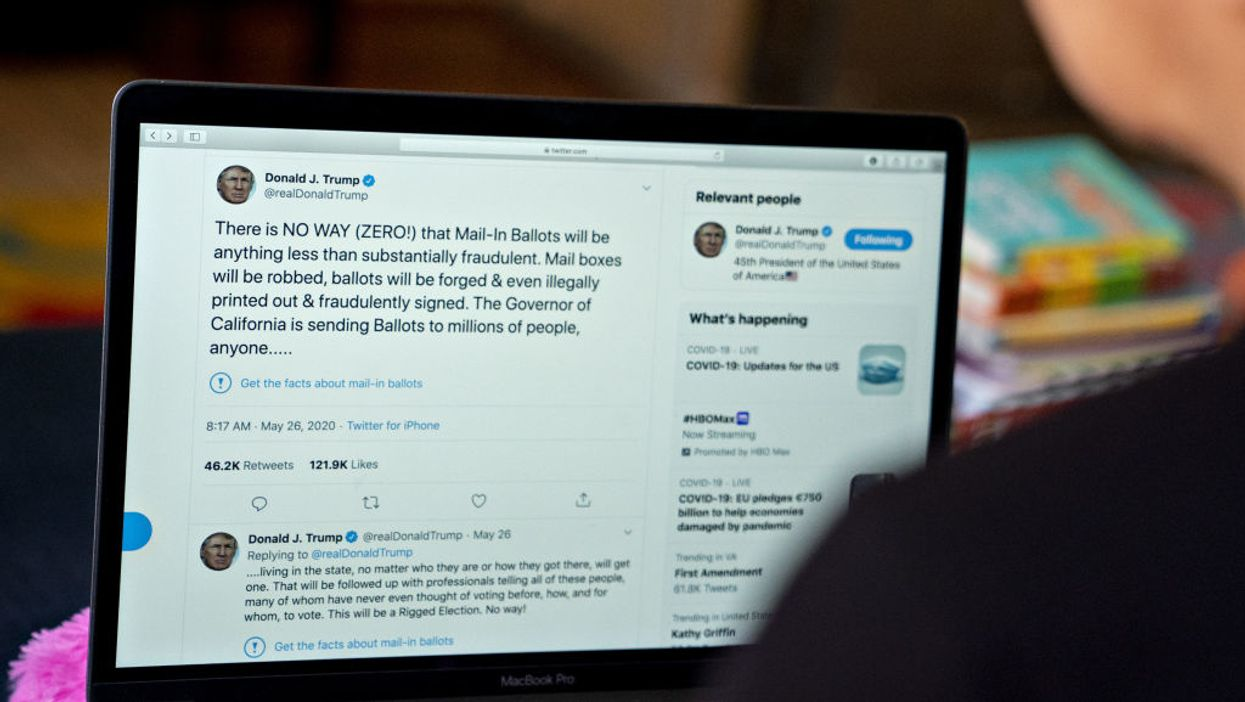 Laptop screen showing tweet from President Donald Trump